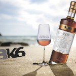 ABK6 VSOP bottle and two glasses on sand